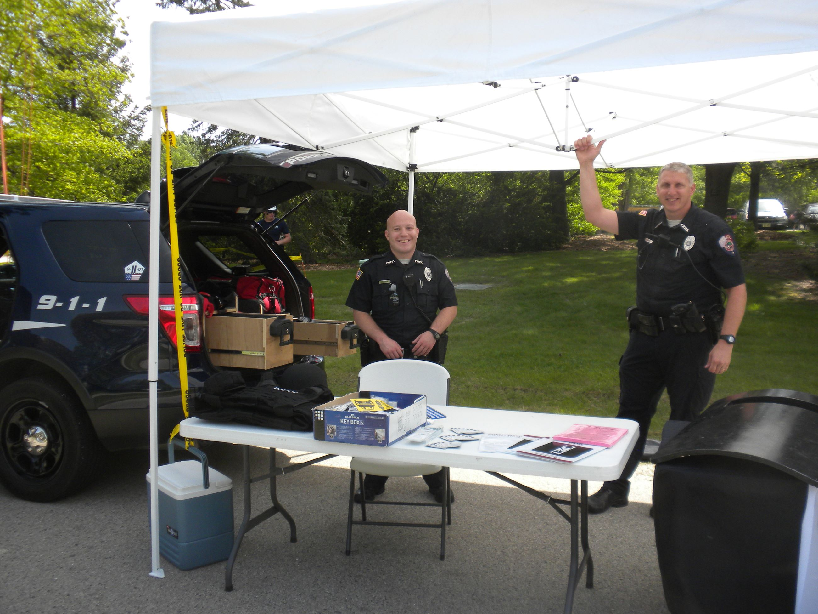Police Officers setting up tent at the Open House